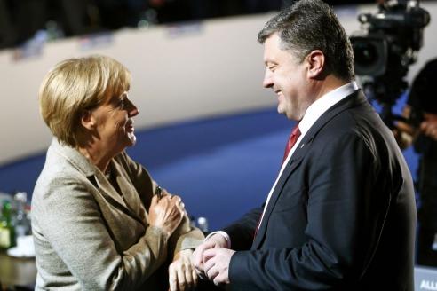 Президент Украины П.Порошенко и канцлер Германии А.Меркель во время встречи в Киеве. 2015 г.